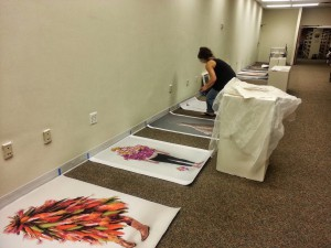 GRA Ceci Cole McInturff installing the exhibit