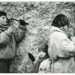 Children at the Wall, West Berlin. by Helmut Brinkmann. 1990.
