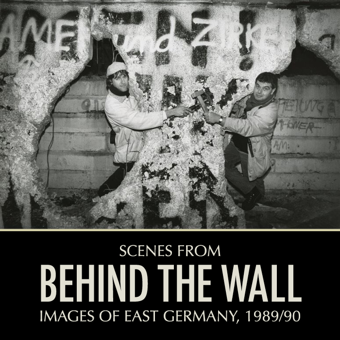 Photographers Page Chichester (left) and Helmut Brinkmann (right)pose at the Berlin Wall with hammers. Photograph possibly taken by an unknown passerby.