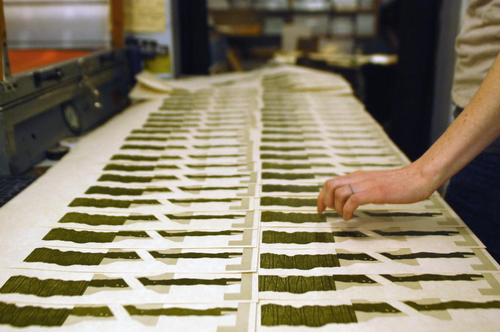 "Artist Sarah McDermott at work on her book,  ""Channel & Flow."" source: Women's Studio Workshop, www.wsworkshop.org"