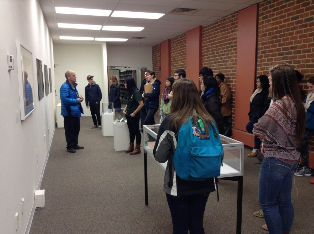 School of Art Professor Ed Bisese (left) talking with his students about Artists' Maps.